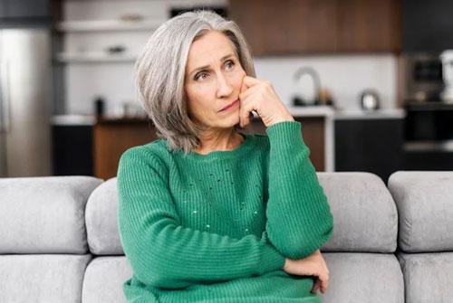 Mature woman thinking stock photo