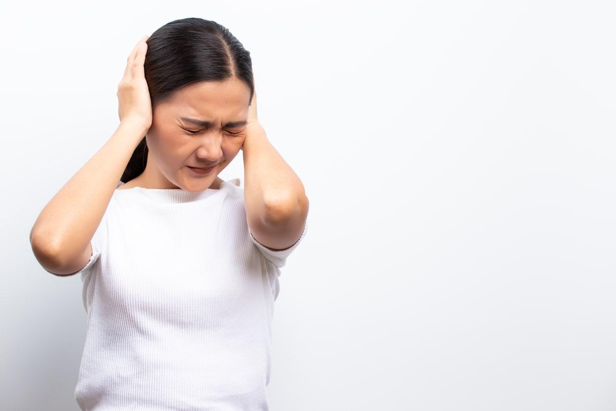 Woman experiencing bad headache. Can headaches be deadly?