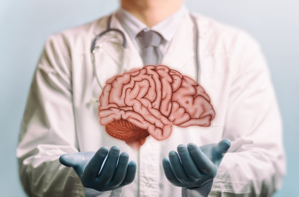 Neurosurgery doctor holding brain illustration