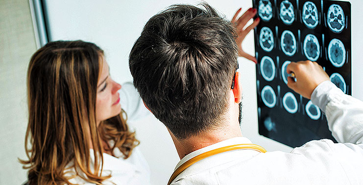 Two doctors discussing CT scans stock image